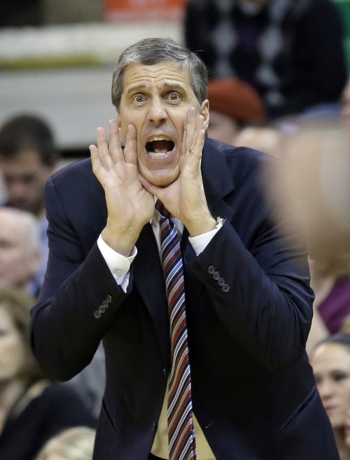 Washington Wizards coach Randy Wittman shouts to his team during the fourth quarter of an NBA basketball game against the Utah Jazz on Saturday, Jan. 25, 2014, in Salt Lake City. The Jazz won 104-101. (AP Photo/Rick Bowmer)