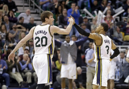 Utah Jazz's Gordon Hayward (20) and teammate Trey Burke (3) celebrate on the court in the fourth quarter during an NBA basketball game against the Washington Wizards Saturday, Jan. 25, 2014, in Salt Lake City. The Jazz won 104-101. (AP Photo/Rick Bowmer)