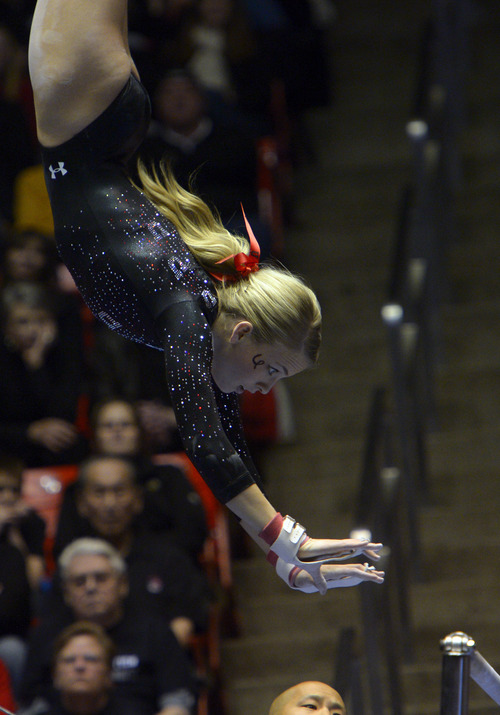 Rick Egan  | The Salt Lake Tribune   Hailee Hansen competes on the bars for the Utes, in Pac12 gymnastics competition, Utah vs. UCLA, at the Huntsman Center, Saturday, January 25, 2014.