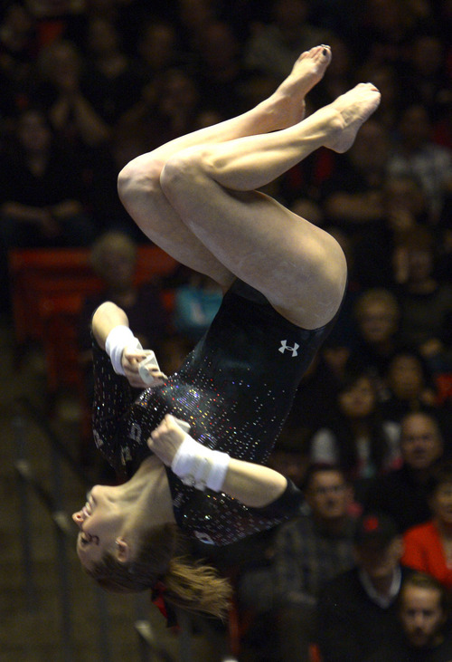Rick Egan  | The Salt Lake Tribune   Breanna Hughes competes on the bars for the Utes, in Pac12 gymnastics competition, Utah vs. UCLA, at the Huntsman Center, Saturday, January 25, 2014.