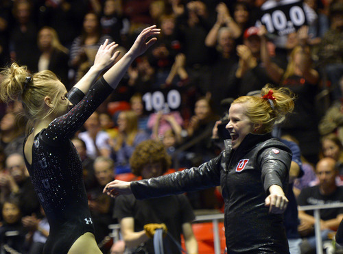 Rick Egan  | The Salt Lake Tribune   Georgia Dabritz, is greeted by Tori Wilson after her performance on the floor for the Utes, in Pac12 gymnastics competition, Utah vs. UCLA, at the Huntsman Center, Saturday, January 25, 2014.
