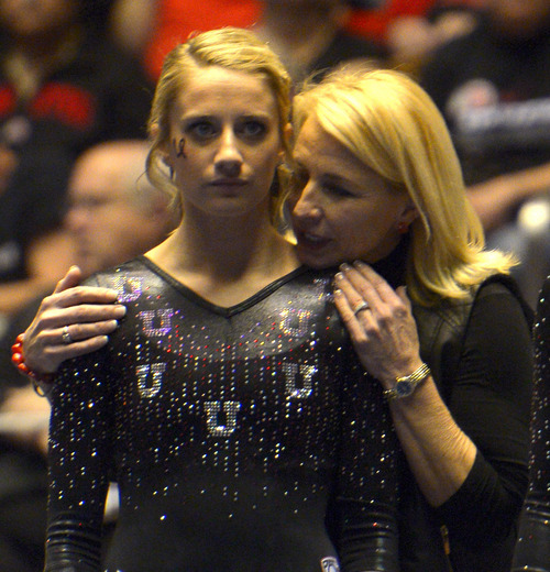 Rick Egan  | The Salt Lake Tribune   Mary Beth Lofgren gets some last minute instructions from coach Megan Marsden, before she competes on the beam for the Utes, in Pac12 gymnastics competition, Utah vs. UCLA, at the Huntsman Center, Saturday, January 25, 2014.