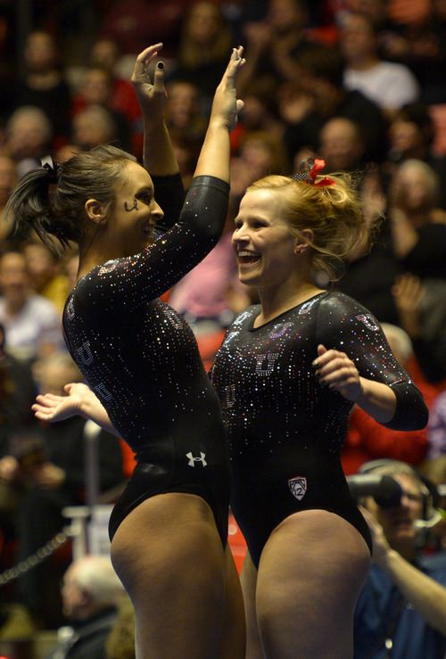 Rick Egan  | The Salt Lake Tribune   Lia Del Priore  and Tory Wilson, after Del Priore's floor routine for the Utes, in Pac12 gymnastics competition, Utah vs. UCLA, at the Huntsman Center, Saturday, January 25, 2014.