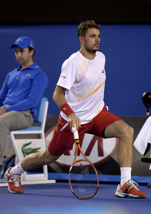 Stanislas Wawrinka of Switzerland does stretches as he plays Rafael Nadal of Spain during the men's singles final at the Australian Open tennis championship in Melbourne, Australia, Sunday, Jan. 26, 2014.(AP Photo/Andrew Brownbill)