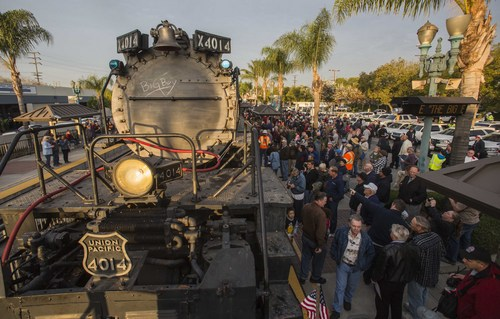Spectators view the historic locomotive, Union Pacific Big Boy No. 4014 at Metrolink Station, Sunday, Jan. 26, 2014, in Covina, Calif. The locomotive will head for Colton over the next several weeks before No. 4014 departs for Union Pacific's Heritage Fleet Operations headquarters in Cheyenne, Wyo. (AP Photo/Ringo H.W. Chiu)