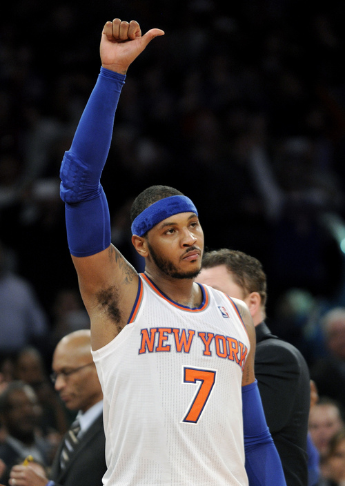 New York Knicks' Carmelo Anthony reacts to the fans after scoring 62 points and coming out of an NBA basketball game during the fourth quarter against the Charlotte Bobcats Friday, Jan. 24, 2014, at Madison Square Garden in New York. The Knicks won 125-96. (AP Photo/Bill Kostroun)