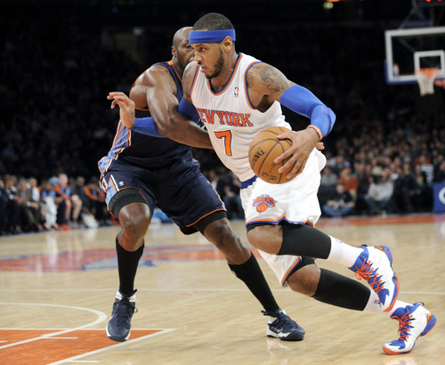 New York Knicks' Carmelo Anthony, right, drives by Charlotte Bobcats' Anthony Tolliver during the second quarter of an NBA basketball game, Friday, Jan. 24, 2014, at Madison Square Garden in New York. (AP Photo/Bill Kostroun)