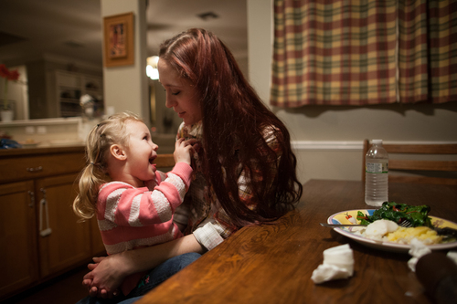 Maggie Barcellano sits down for dinner with her daughter, Zoe, 3, at Barcellano's father's house in Austin, Texas on Saturday, Jan. 25, 2014. Barcellano, who lives with her father, enrolled in the food stamps program to help save up for paramedic training while she works as a home health aide and raises her daughter. Working-age people now make up the majority in U.S. households that rely on food stamps, a switch from a few years ago when children and the elderly were the main recipients.  (AP Photo/Tamir Kalifa)