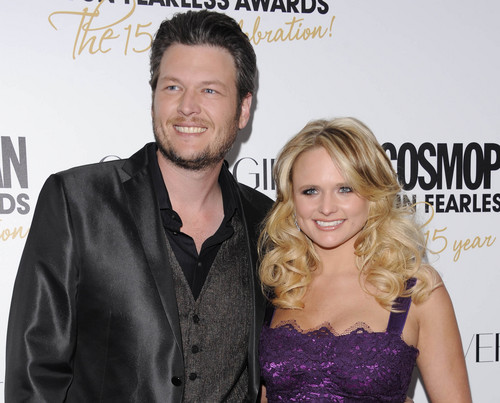 """FILE - This March 5, 2012 file photo shows country singers Blake Shelton, left, and his wife, Miranda Lambert at Cosmopolitan Magazine's """"Fun Fearless Males and Females of 2012"""" awards in New York.  (AP Photo/Evan Agostini, file)"""