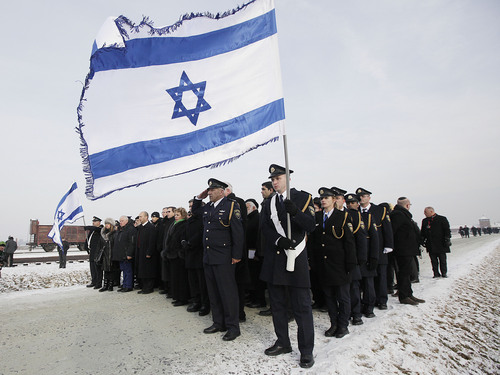 Members of Israeli parliament, the Knesset, attend a ceremony to mark the 69th anniversary of the liberation of Auschwitz Nazi death camp's  in Oswiecim, Poland, on Monday, Jan. 27, 2014, since the Soviet Red Army liberated the camp. The Nazis killed some 1.5 million people, mostly Jews at the camp during World War II. (AP Photo/Czarek Sokolowski)