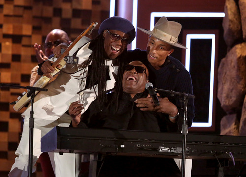 Nile Rodgers, from left, Stevie Wonder and Pharrell Williams perform at the 56th annual Grammy Awards at Staples Center on Sunday, Jan. 26, 2014, in Los Angeles. (Photo by Matt Sayles/Invision/AP)