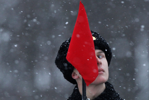 A soldier looks on during a parade marking the 70th anniversary of the battle that lifted the Siege of Leningrad in St.Petersburg, Russia, Monday, Jan. 27, 2014. The Nazi German and Finnish siege and blockade of Leningrad, now known as St. Petersburg, was broken on Jan. 18, 1943 but finally lifted Jan. 27, 1944. More than 1 million people died mainly from starvation during the 900-day siege. (AP Photo/Dmitry Lovetsky)