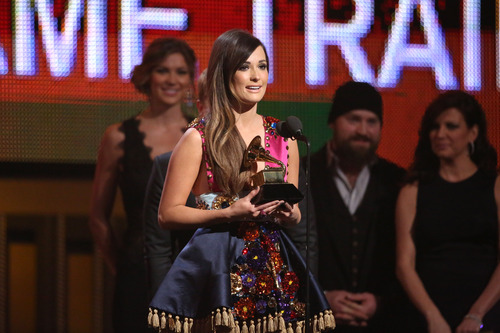 Kacey Musgraves accepts the award for best country album at the 56th annual GRAMMY Awards at Staples Center on Sunday, Jan. 26, 2014, in Los Angeles. (Photo by Matt Sayles/Invision/AP)