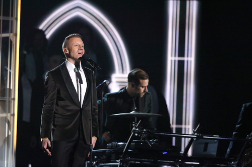 """Macklemore performs """"Same Love"""" on stage at the 56th annual Grammy Awards at Staples Center on Sunday, Jan. 26, 2014, in Los Angeles. (Photo by Matt Sayles/Invision/AP)"""