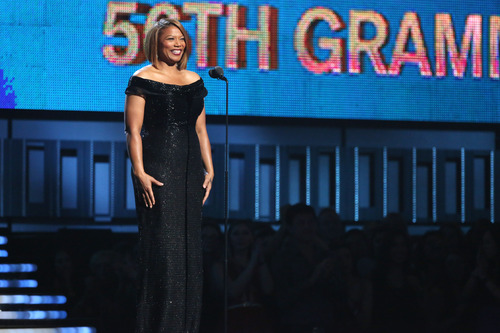 """Queen Latifah introduces a performance of """"Same Love"""" by Macklemore Ryan Lewis, with Mary Lambert, Trombone Shorty and Madonna at the 56th annual Grammy Awards at Staples Center on Sunday, Jan. 26, 2014, in Los Angeles. (Photo by Matt Sayles/Invision/AP)"""