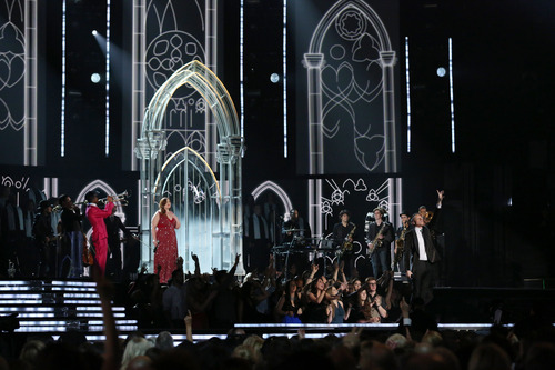 """Mary Lambert, center left, and Macklemore, right, perform """"Same Love"""" at the 56th annual Grammy Awards at Staples Center on Sunday, Jan. 26, 2014, in Los Angeles. (Photo by Matt Sayles/Invision/AP)"""