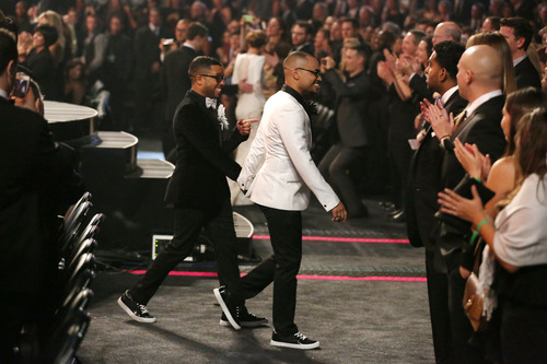 """Audience members participate in a same sex wedding during a performance of """"Same Love"""" by Macklemore and Ryan Lewis at the 56th annual Grammy Awards at Staples Center on Sunday, Jan. 26, 2014, in Los Angeles. (Photo by Matt Sayles/Invision/AP)"""