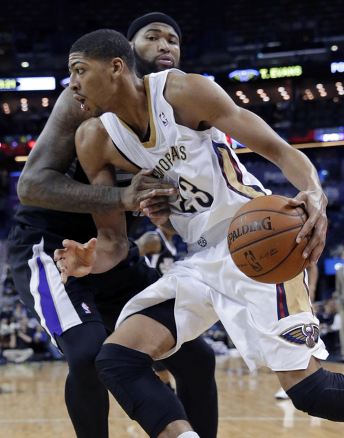 FILE - In this Jan. 21, 2014, file photo, New Orleans Pelicans power forward Anthony Davis (23) drives to the basket against Sacramento Kings center DeMarcus Cousins in the second half of an NBA basketball game in New Orleans. The Pelicans' star big man would like to represent host-city New Orleans at next month's All-Star game, and his performance in his second pro season has made him a solid candidate.  (AP Photo/Gerald Herbert, File)