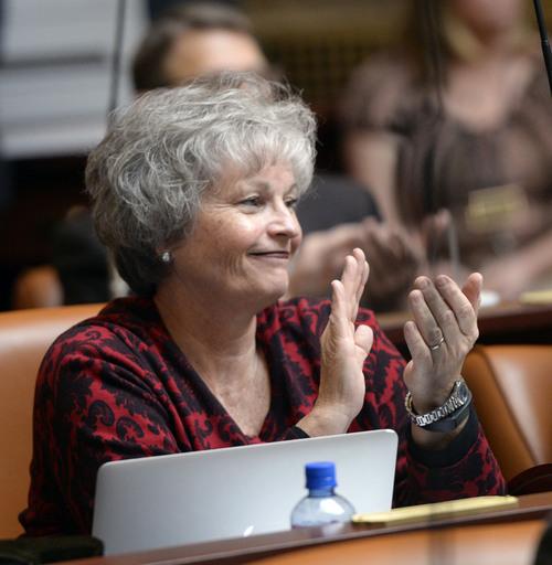 Al Hartmann  |  The Salt Lake Tribune Rep.Ronda Rhonda Menlove applauds during opening remarks of  Speaker of the House Becky Lockhart starting the 45-day long 2014 Utah  legislative session Monday January 27.