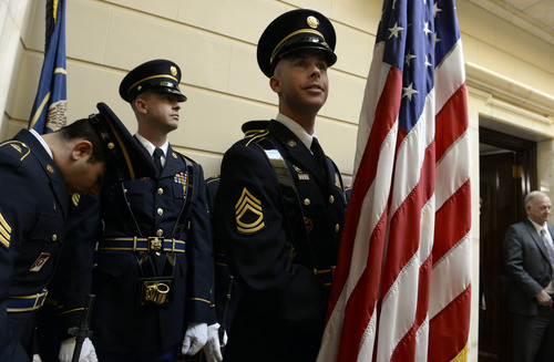 Francisco Kjolseth  |  The Salt Lake Tribune Utah National Guard members, Anthony Baca, and twins Aaron and Leland Slaughter, from left, get ready to post the colors in the Senate chambers for the start of the 45-day 2014 legislative session on Monday, Jan. 27, at the Utah State Capitol.