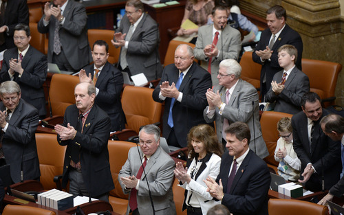 Al Hartmann  |  The Salt Lake Tribune Members of the House of Representatives rise and clap during opening remarks of  Speaker of the House Becky Lockhart starting the 45-day long 2014 Utah legislative session Monday January 27.