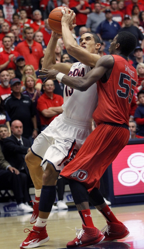Arizona's Nick Johnson (13) shoots as Utah's Delon Wright (55) defends in the first half of an NCAA college basketball game on Sunday, Jan. 26, 2014, in Tucson, Ariz. (AP Photo/John Miller)