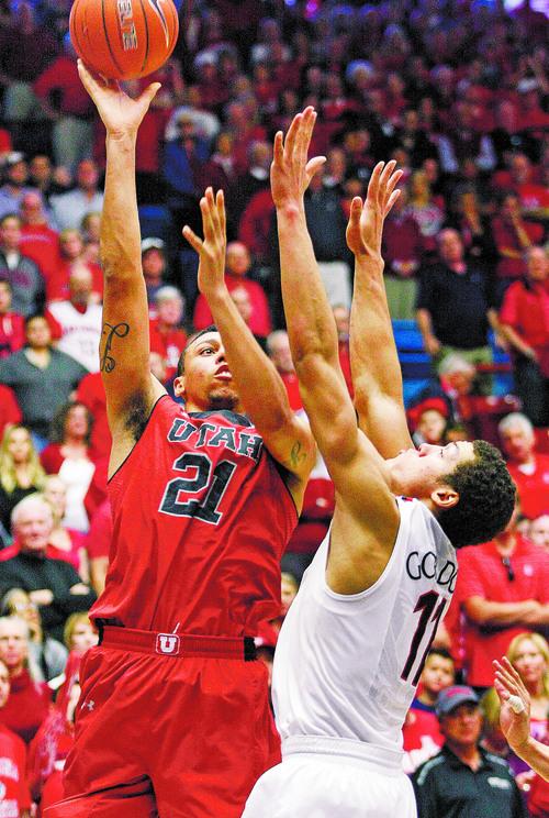 Utah's Jordan Loveridge (21) shoots for two over the defense of Arizona's Aaron Gordon (11) in the second half of an NCAA college basketball game on Sunday, Jan. 26, 2014, in Tucson, Ariz. (AP Photo/John Miller)