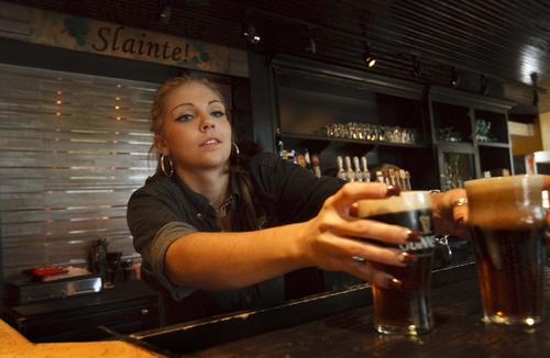 Leah Hogsten  |  The Salt Lake Tribune  After waiting for nearly two years, MacCool's Public House in Ogden has received a bar license, enabling the pub-style family restaurant to tear down its Zion Curtain and allow bartender Samantha Grotta to hand patrons a beer over the bar, Wednesday, September 26 2012 in Ogden.  Under Utah law, bartenders, beer taps and open bottles of liquor must be hidden from public view in restaurants.