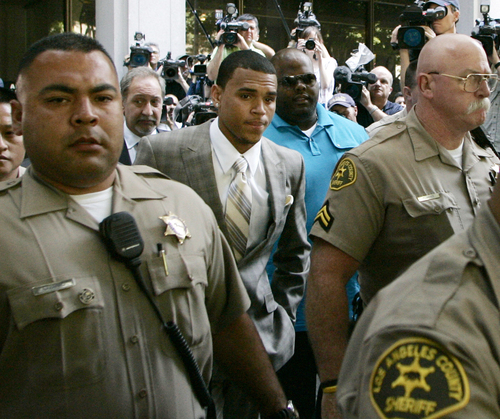 FILE - In this June 22, 2009 file photo, Chris Brown leaves his preliminary hearing after pleading guilty to one count of felony assault, in Los Angeles County Superior Court.  The R&B's 2009 arrest hours before the Grammy Awards for the brutal beating of then-girlfriend Rihanna shattered Brown's squeaky-clean image. The singer's career rebounded and he went on to win a Grammy Award, but has stumbled in recent months with allegations that he lied about performing his community service, didn't exchange the proper information after a fender-bender and hit a man outside a Washington, D.C. hotel. (AP Photo/Danny Moloshok, File)