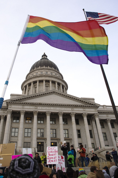 Steve Griffin  |  The Salt Lake Tribune  A rainbow flag flaps in the breeze as same-sex marriage supporters gathered on the steps of the Utah State Capitol in Salt Lake City to rally support for their cause Tuesday, January 28, 2014.