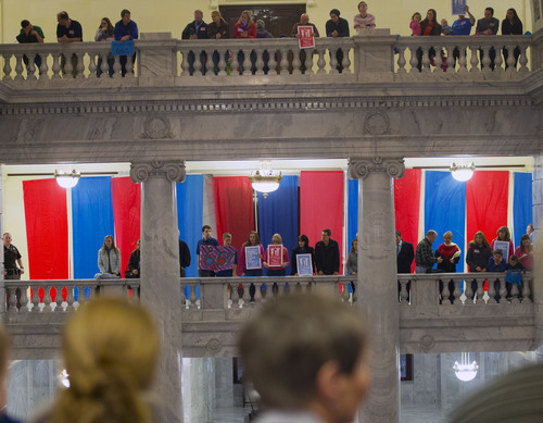 Steve Griffin  |  The Salt Lake Tribune  Supporters line the upper floors of the Capitol as hundreds of advocates of traditional marriage filled the Rotunda as they rally at the Utah State Capitol in Salt Lake City Wednesday, January 29, 2014.