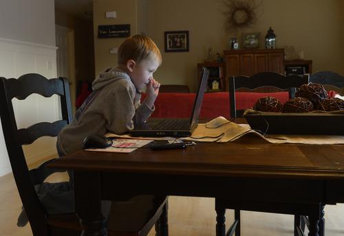 Rick Egan  | The Salt Lake Tribune   Five-year-old Ashton VanLeeuwen  works on the UPSTART preschool software program at his home in West Jordan, Wednesday, January 22, 2014.