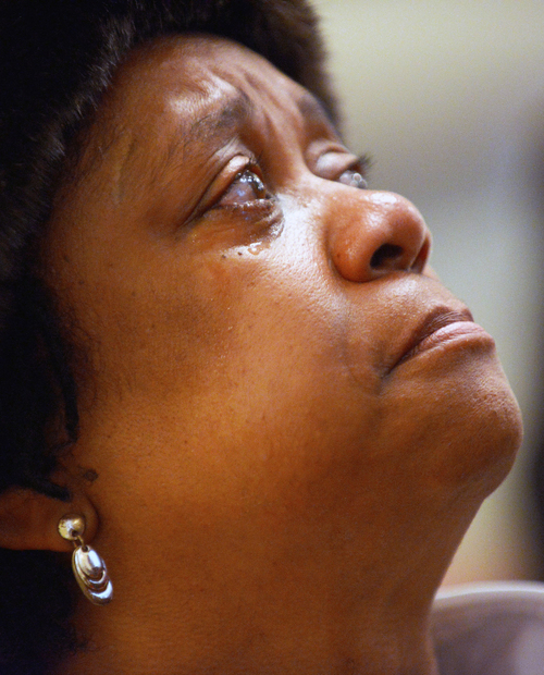 Pastor Florence Nicholson, of Restoration Church of Christ in Wilson, N.C., sheds a tear during the Concert of Prayer, Tuesday, Jan. 28, 2014, at Word Tabernacle Church in Rocky Mount, N.C. Nicholson came to the concert to support her home community of Rocky Mount. Police in a North Carolina town are searching for a man who sprayed a church playground with gunfire, striking four youths and leaving a 12-year-old boy gravely wounded. (AP Photo/Rocky Mount Telegram, Hannah Potes)