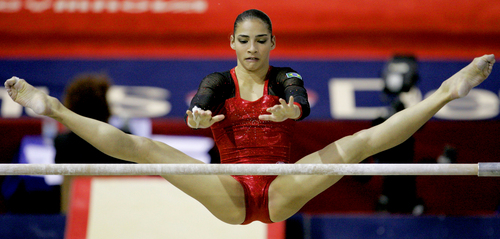 Brazil's Lais Souza performs on the uneven bars during women's qualification for the Gymnastics World Championships at the NRGi Arena in Aarhus, Denmark, Monday Oct. 16, 2006.  (AP Photo/Matt Dunham)
