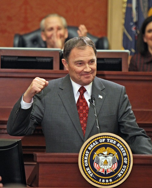 Utah Governor Gary Herbert gestures as he talks about the Utah State University football team as he delivers the State of the State speech to the Utah State Legislature on Capitol Hill, Wednesday, January 30, 2013, in Salt Lake City. (AP Photo/Tom Smart,Pool)