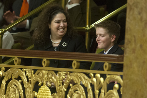 Chris Detrick  |  The Salt Lake Tribune Heart transplant survivor Allyson White Gamble and her son Ben smile as she is recognized during Utah Gov. Gary Herbert's State of the State address at the Utah State Capitol Wednesday January 30, 2013.