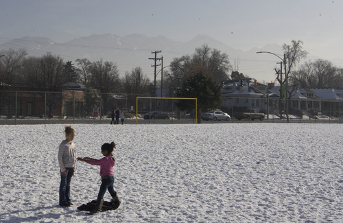 Keith Johnson |  Tribune file photo  Inversion partially obscures the Wasatch Mountains as Hawthorne Elementary School students enjoy recess, December 17, 2013, in Salt Lake City.
