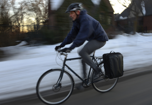 Scott Sommerdorf   |  The Salt Lake Tribune Jason Hamula, a family practice doctor rides his bike home from work during an orange alert bad air day, Friday, January 24, 2014.