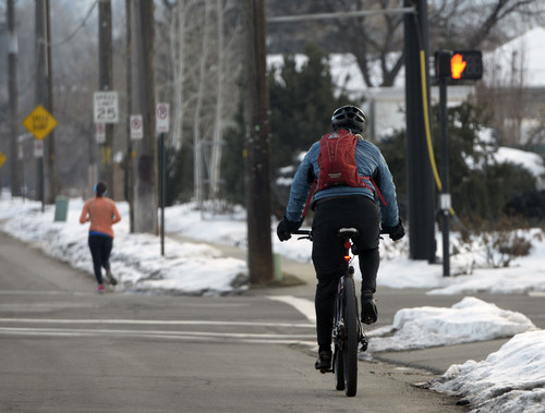 Al Hartmann  |  The Salt Lake Tribune A runner and bicyclist in the Millcreek area of Salt Lake County get their excercise early Monday morning December 30 as unhealthy air increases.   The Utah Division of Air Quality rated the air in the orange range with a health advisory for elderly and persons with existing heart or lung disease to stay indoors and reduce physical activity.