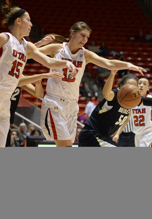 Steve Griffin     The Salt Lake Tribune   Utah Utes forward Michelle Plouffe (15) and forward Emily Potter (12) knock the ball from Colorado Buffaloes forward Jamee Swan (50) during second half action in the Utah versus Colorado women's basketball game at the Huntsman Center in Salt Lake City, Utah Thursday, January 30, 2014.