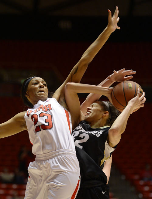 Steve Griffin     The Salt Lake Tribune   Utah Utes forward Ariel Reynolds (23), left, fouls Colorado Buffaloes forward Arielle Roberson (32) while trying to block her shot during second half action in the Utah versus Colorado women's basketball game at the Huntsman Center in Salt Lake City, Utah Thursday, January 30, 2014.
