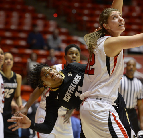 Steve Griffin     The Salt Lake Tribune   Colorado Buffaloes guard Brittany Wilson (11) looks up as she crashes to the floor after trying to shoot over Utah Utes forward Emily Potter (12) during second half action in the Utah versus Colorado women's basketball game at the Huntsman Center in Salt Lake City, Utah Thursday, January 30, 2014.