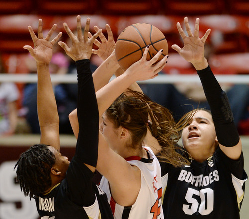 Steve Griffin     The Salt Lake Tribune   Utah Utes forward Emily Potter (12) gets trapped by Colorado Buffaloes guard Brittany Wilson (11) and forward Jamee Swan (50) during second half action in the Utah versus Colorado women's basketball game at the Huntsman Center in Salt Lake City, Utah Wednesday, January 29, 2014.