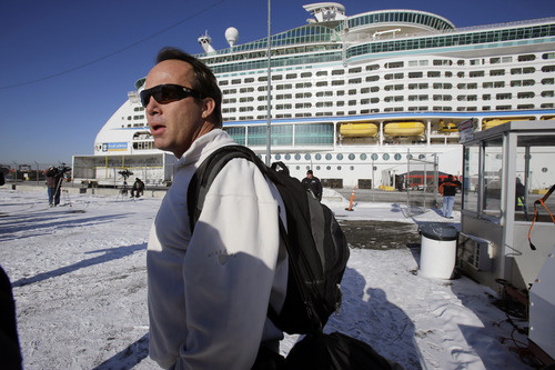 Rick O'Shea answers a question as he waits to board the Explorer of the Seas cruise ship after it docked at a berth in Bayonne, N.J., Wednesday, Jan. 29, 2014. O'Shea says his company BYOPlanet services is preparing to disinfect the ship. The number of passengers and crew reported stricken ill on the cruise ship has risen to nearly 700.    (AP Photo/Mel Evans)