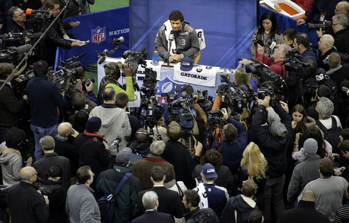 Seattle Seahawks' Russell Wilson answers a question during media day for the NFL Super Bowl XLVIII football game Tuesday, Jan. 28, 2014, in Newark, N.J. (AP Photo/Charlie Riedel)