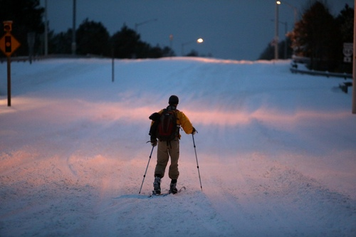 John Fitzgerald, a lineman for Dominion Power, uses cross-country skis on Hanbury Road in Chesapeake, Va. to get to work on Wednesday, Jan. 29, 2014. The National Weather Service says the Norfolk area averages fewer than three days of snow each winter that result in at least an inch of accumulation. Wednesday marks the fourth day in less than two weeks that at least an inch of snow has fallen. (AP Photo/The Virginian-Pilot, Steve Earley)