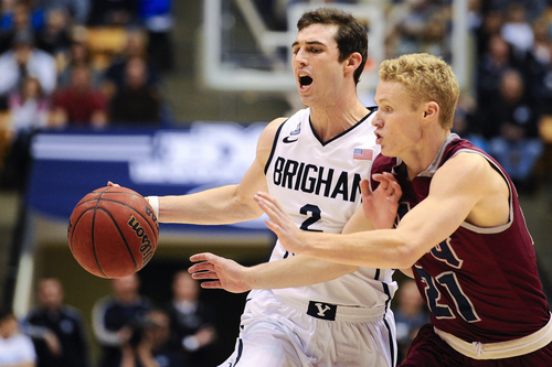 BYU guard Matt Carlino attempts to drive past Loyola Marymount's Max Heller during an NCAA college basketball game Saturday, Jan. 11, 2014, in Provo, Utah. (AP Photo/Daily Herald, Alex Goodlett)