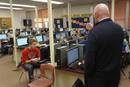 Garrett Bryant | Courtesy Tooele Junior High Sen. Howard Stephenson, R-Draper, visits a math lab at Tooele Junior High School earlier this month, asking students what they think of the ALEKS software. The school is one of 40 that piloted various math software programs for the STEM Action Center.