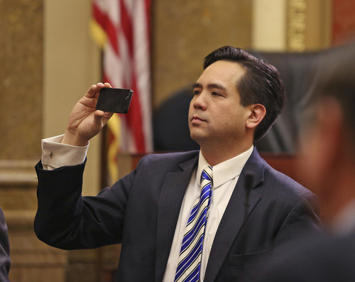 Tom Smart | Pool Utah Attorney General Sean Reyes takes a photo before Governor Gary R. Herbert delivers his 2014 State of the State address Wednesday, Jan. 29, 2014, in Salt Lake City.