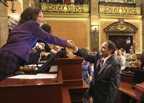 Speaker of the House Becky Lockhart, R-Provo, shakes hands with Governor Gary R. Herbert before he delivers his 2014 State of the State address Wednesday, Jan. 29, 2014, in Salt Lake City.